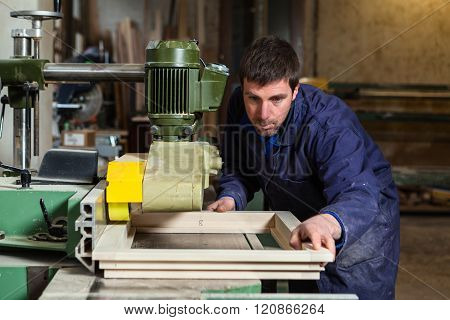 Carpenter Man Working With Tablesaw In Workshop