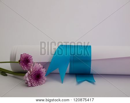 Diploma tied with a blue ribbon