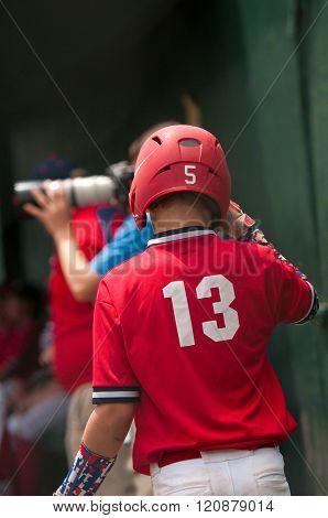 Baseball boy getting ready to bat.
