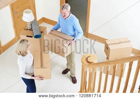 Mature Couple Moving In To New Home