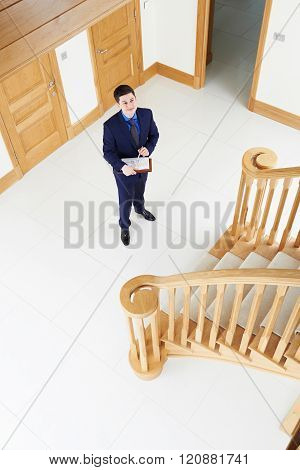 Male Realtor Looking Around Vacant New Property
