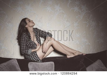 Sexy Girl On Backrest Of Sofa