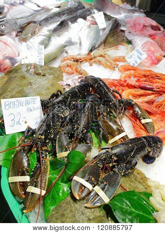 Fresh lobsters and seafood at fish marrket in Spain