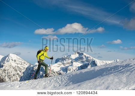 Man Snowshoeing In Mountain