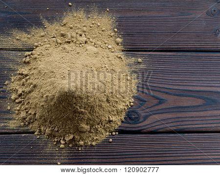 Henna Powder Pile On The Dark Wooden Planks