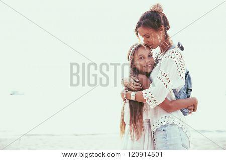 Tween daughter hugging with her mom, boho oriental style poster