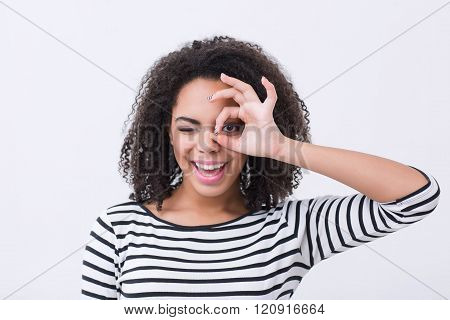 Cheerful mulatto woman smiling