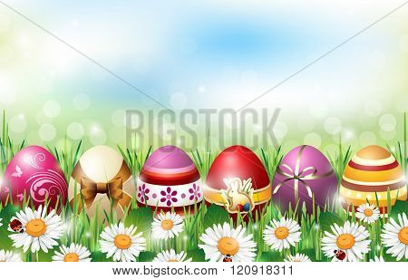 Easter Background with Colorful Eggs lying in Fresh Grass full of Flowers with Ladybirds in front of De-focused Lights