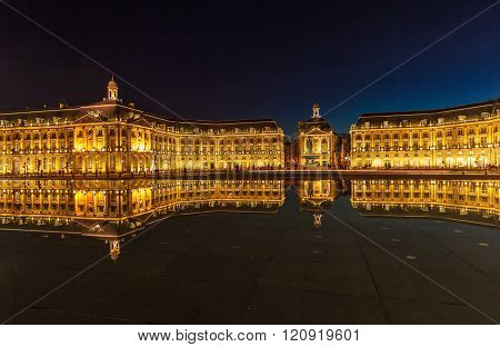 Place de la Bourse (1745-1747, designed by Jacques-Ange Gabriel) and water mirror at night, Bordeaux, France poster