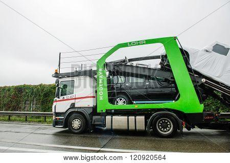 HUNGARY - SEPTEMBER 18 2013: New luxury Mercedes-Benz G-Class SUV cars being transported on a HODLMAYR trailer near Hungarian border. Hodlmayr is an Austrian international transportation company