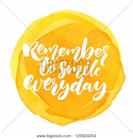 Remember to smile everyday. Inspirational quote for posters and cards. Brush calligraphy on yellow w