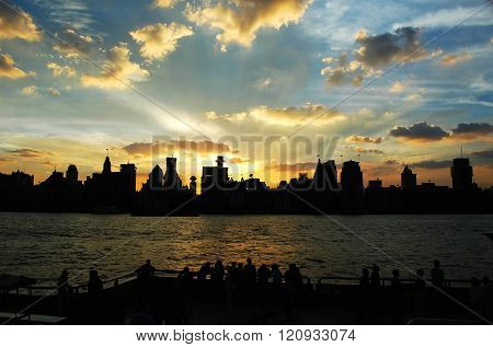 Shanghai city skyline at waterfront under dusk sunlight