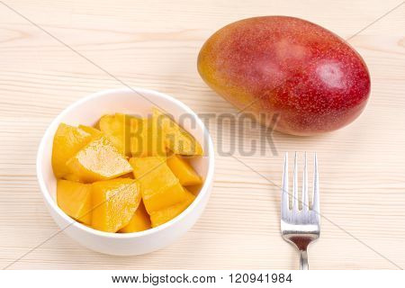 Cut and whole mango
