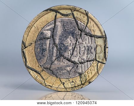 One euro coin cracked as metaphor of euro currency collapse