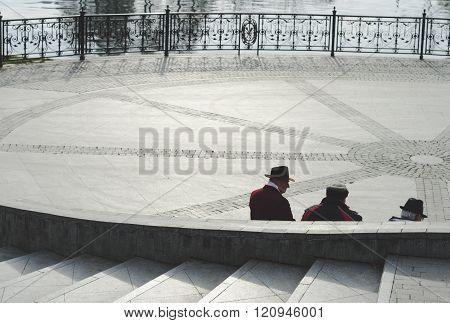 Three senior elegant men talking to each other