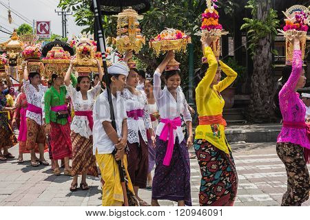 Ubud, Bali - March 8: Village Women Carry Offerings Of Food Baskets On Their Heads In A Procession T