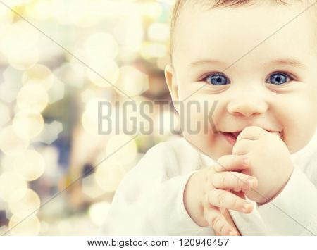 child, happiness and people concept - adorable baby