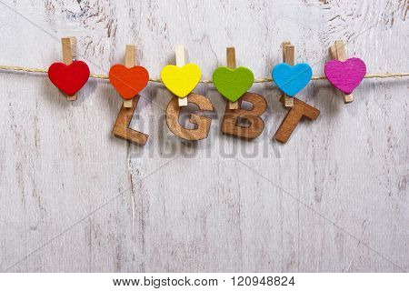 Lgbt Rainbow And Hearts On A White Wooden Background