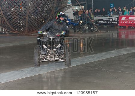 Stuntman riding a quad bike, ATV during stunt show