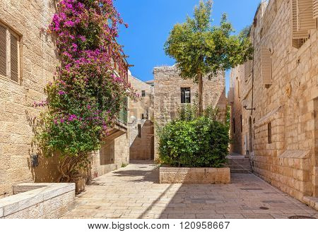 Narrow street among typical houses of Jewish Quarter in Old City of Jerusalem, Israel.