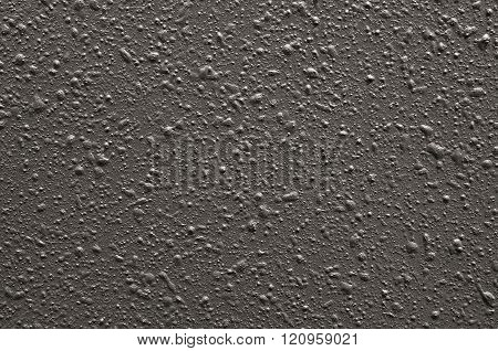 Abstract pimply gray background or texture. Concrete textured backdrop.
