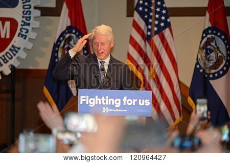 Bridgeton, MO/USA â?? March 08, 2016: Former president Bill Clinton salutes to supporters while campaigning for his wife, at District 9 Machinists Hall in Bridgeton, a suburb of St. Louis.