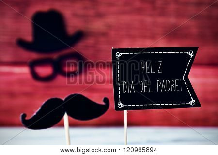 a black flag-shaped signboard with the text feliz dia del padre, happy fathers day in spanish, and a mustache, a pair of eyeglasses and a hat forming the face of a man