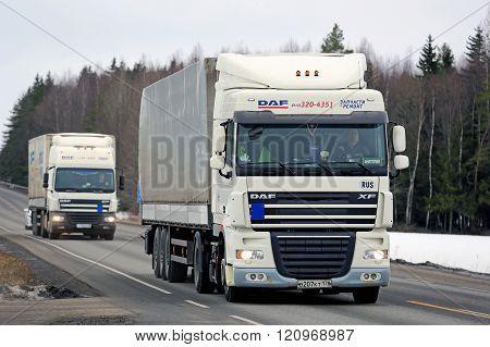 Two White DAF Cargo Trucks Platooning