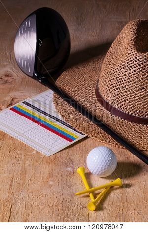 Siesta - Straw Hat And Golf Driver On A Wooden Desk