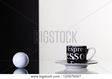 Black  Cup Of Coffee And White Golf Ball