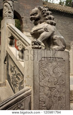 Stairs with stone lion in Chinese park