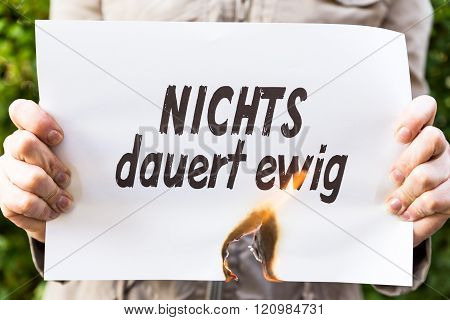 Woman Is Holding A Burning Paper With Text