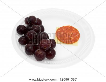 Pepperoni And Cheddar Cheese With Grapes On A Foam Plate