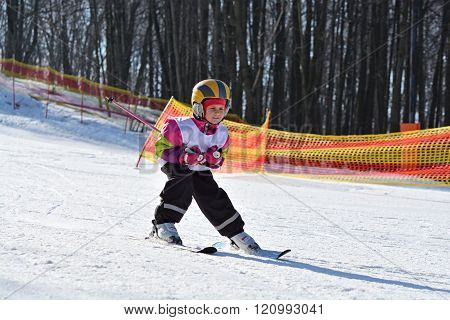 Skiing. Children's ski school. Girl on skis