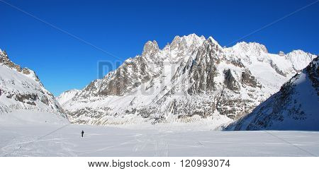 Skiing. Winter mountain landscape. Lone skier