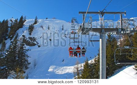 Skiing. Winter mountain landscape. Skiers. Ski lift.