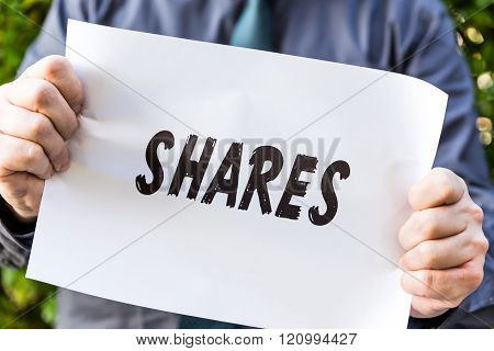 Businessman Is Holding A Paper With Text
