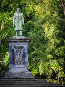 Man sculpture in th Josй do Canto Botanical Garden in Ponta Delgada, the capital of Sao Miguel island, Azores, Portugal poster