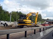 road works. road construction. construction in the motorway/highway.mechanical digger digging the ground poster