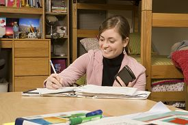 Female student studying in her dormitory