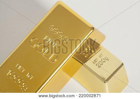 Gold bullion ingot on a white background