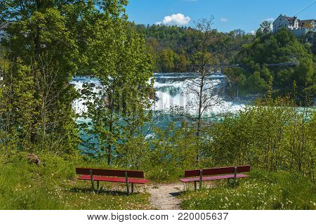 Bench with a view on Rhein Waterfall. Germany