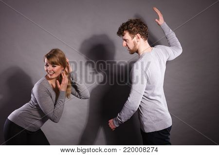 Violence against woman. Aggressive man yelling shouting on scared afraid woman. Negative relations in partnership. Expressive young male beating frightened lady.