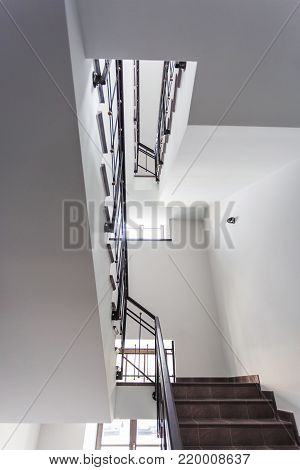 A White Stairs  Emergency And Evacuation Exit Stair In Up Ladder In A New Office Building With Sunsh