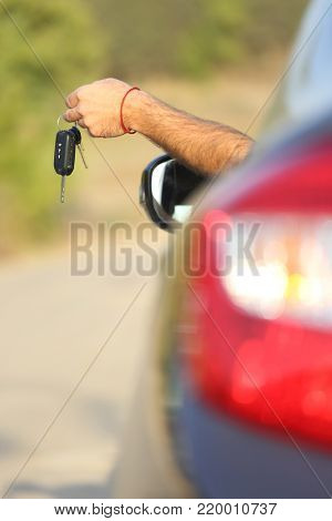 Keys from the new car in the driver's hand