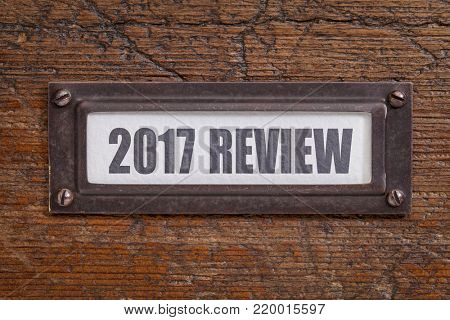 2017 review - a label on grunge wooden file cabinet. A passing year summary and review concept.