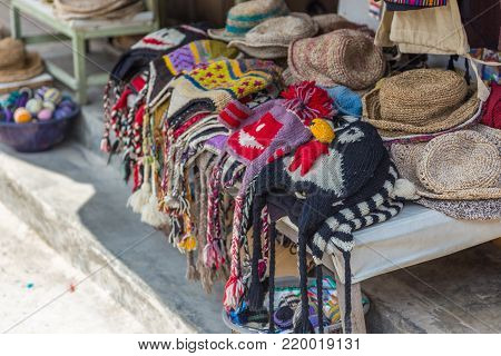 POKHARA, NEPAL - September 29, 2013: Street stand with hats with an inscription, souvenir from Nepal. Street of Pokhara.