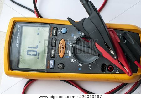Modern multimeter with insulation test, isolated on white background.