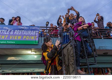 POKHARA, NEPAL - September 30: Tourists awaiting the sunrise at the Sarangkot lookout point. Pokhara is the starting point for most of the treks in the Annapurna area.