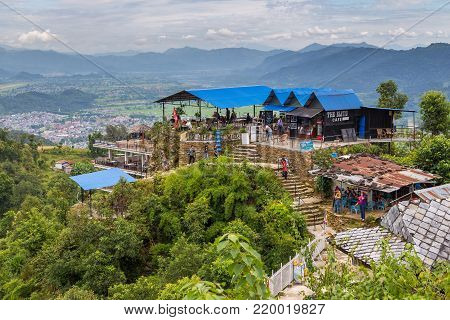 POKHARA, NEPAL - October 01, 2013: Restaurant terrace on the background of the mountain in Pokhara. Pokhara is the starting point for most of the treks in the Annapurna area.